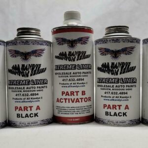 Two medium-sized cans of black paint and one tall can of auto paint activator